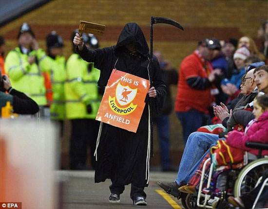30F1C78800000578-0-A_Liverpool_fan_dressed_as_the_Grim_Reaper_walks_in_front_of_the-a-3_1455005731658