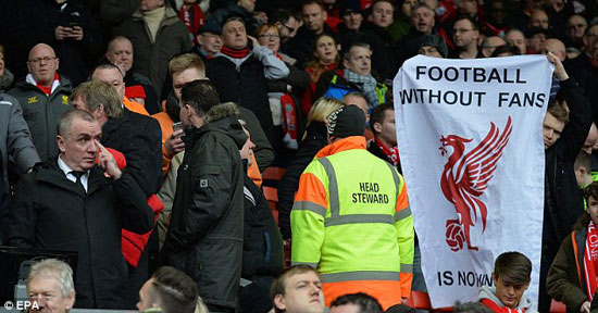 30F0533A00000578-0-A_Liverpool_fan_holds_a_banner_reading_Football_without_fans_is_-a-14_1454782123938