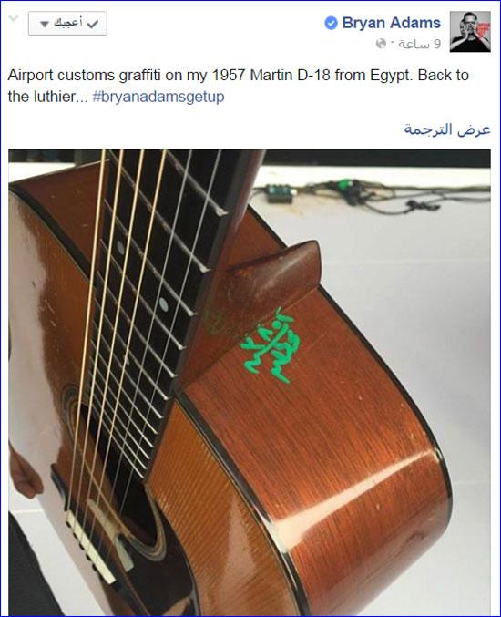 المطرب براين أدمز ينشر صورا توضح ختم سلطات مطارالقاهرة الجيتار الخاص به