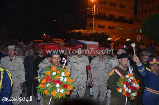 سيارات الإسعاف عند وضع الجثامين فيهما -اليوم السابع -4 -2015