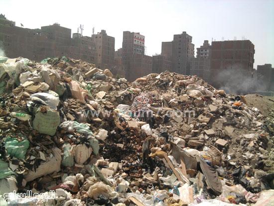 أكوام من القمامة بشارع ترعة المجنونة -اليوم السابع -4 -2015