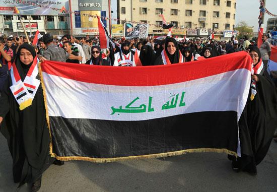 العراقيين يتظاهرون بساحة التحرير بقلب بغداد (6)