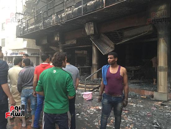 حريق معرض السيارات فيصل الهرم معرض سيارات مطافى (8)