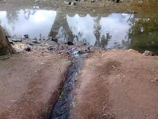 مجرى لنزول مياه الصرف فى بحر بيلا -اليوم السابع -5 -2015