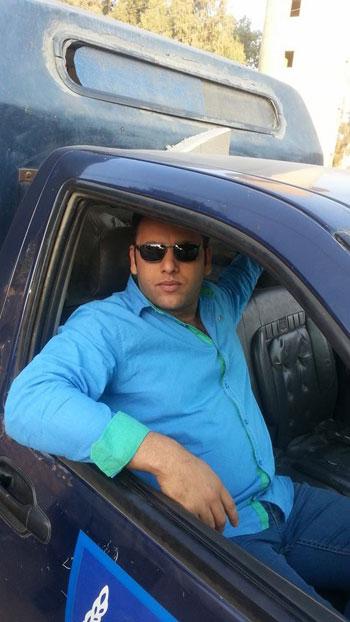 الرائد صلاح الحسينى فى سيارة الشرطة -اليوم السابع -5 -2015