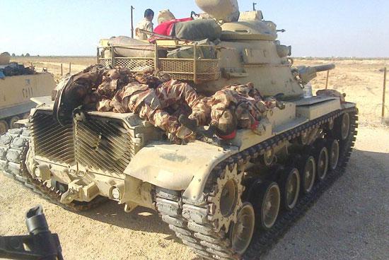 صور قتلى العناصر الإرهابية أعلى دبابة للجيش المصرى  -اليوم السابع -7 -2015