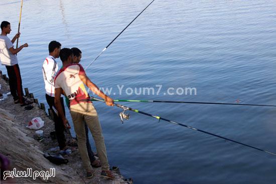 تنتشر هواية صيد الأسماك فى رمضان  -اليوم السابع -7 -2015