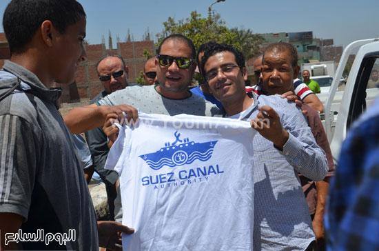 توزيع تى شرتات تحمل اسم القناة -اليوم السابع -8 -2015