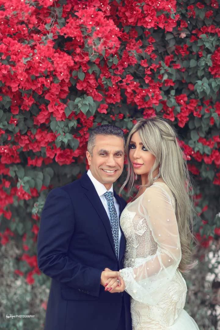 العميد محمد سمير وزوجته إيمان أبو طالب