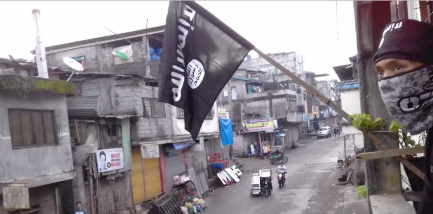 أعلام داعش في المدينة