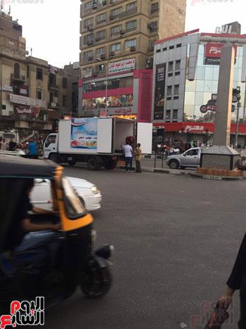 الداخلية توزع وجبات مجانية على الصائمين بمحيط مطار القاهرة  (5)