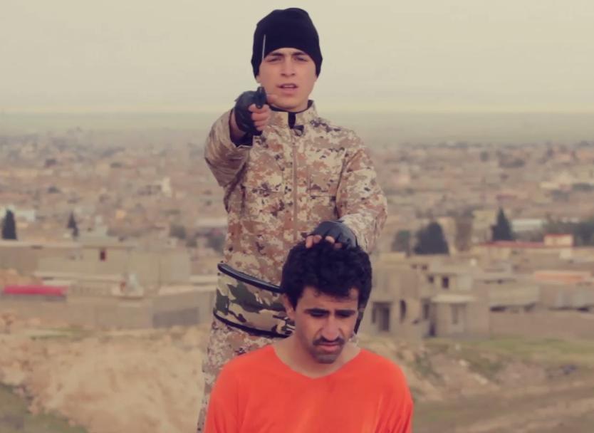 طفل داعشي يذبح رجل
