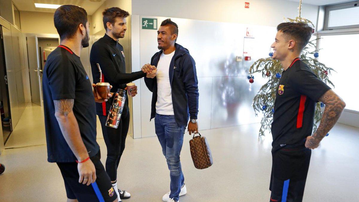كوتينيو مع بيكيه وسواريز وباولينيو