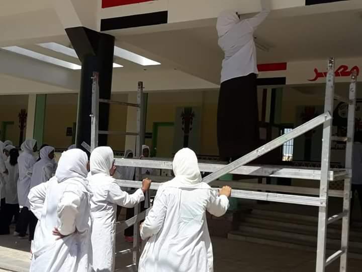 مبادرة لتنظيف شوارع مدينة نصر النوبة بأسوان ورسم جدرانها  (3)