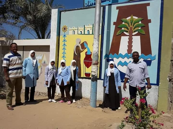 مبادرة لتنظيف شوارع مدينة نصر النوبة بأسوان ورسم جدرانها  (6)