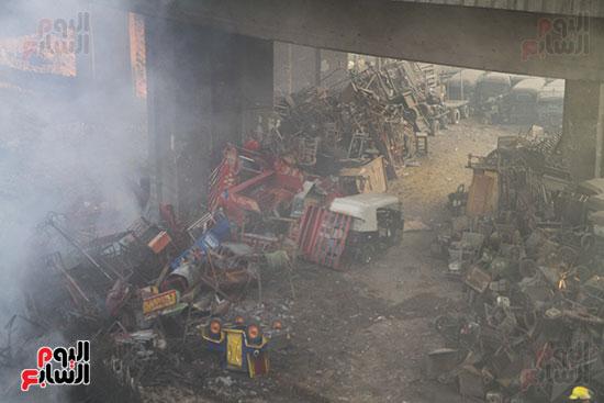 صور حريق مخزن الهرم (11)
