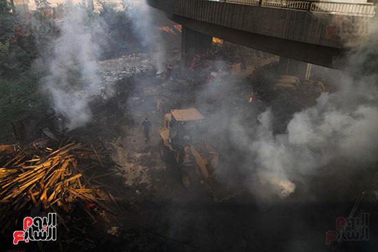 صور حريق مخزن الهرم (16)