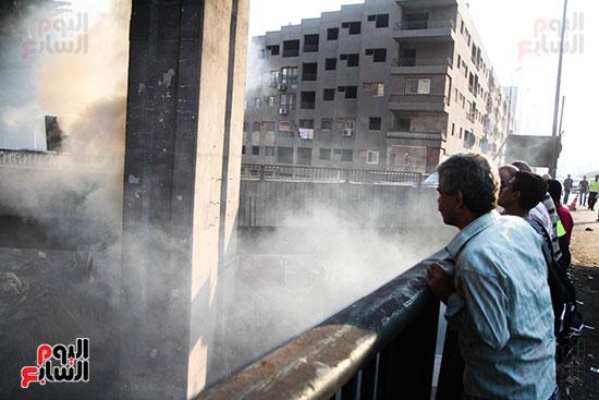 صور حريق مخزن الهرم (14)
