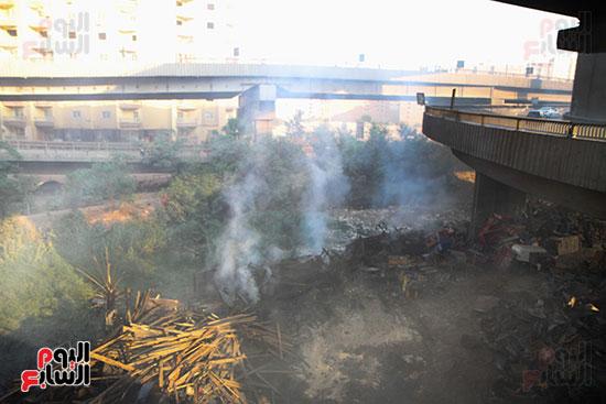 صور حريق مخزن الهرم (6)