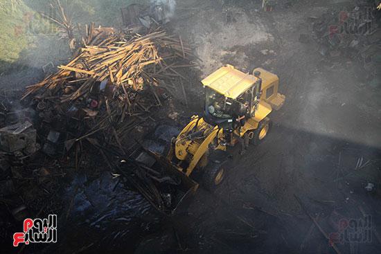 صور حريق مخزن الهرم (7)
