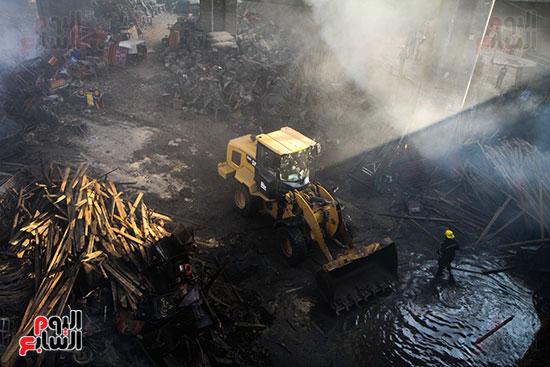 صور حريق مخزن الهرم (8)