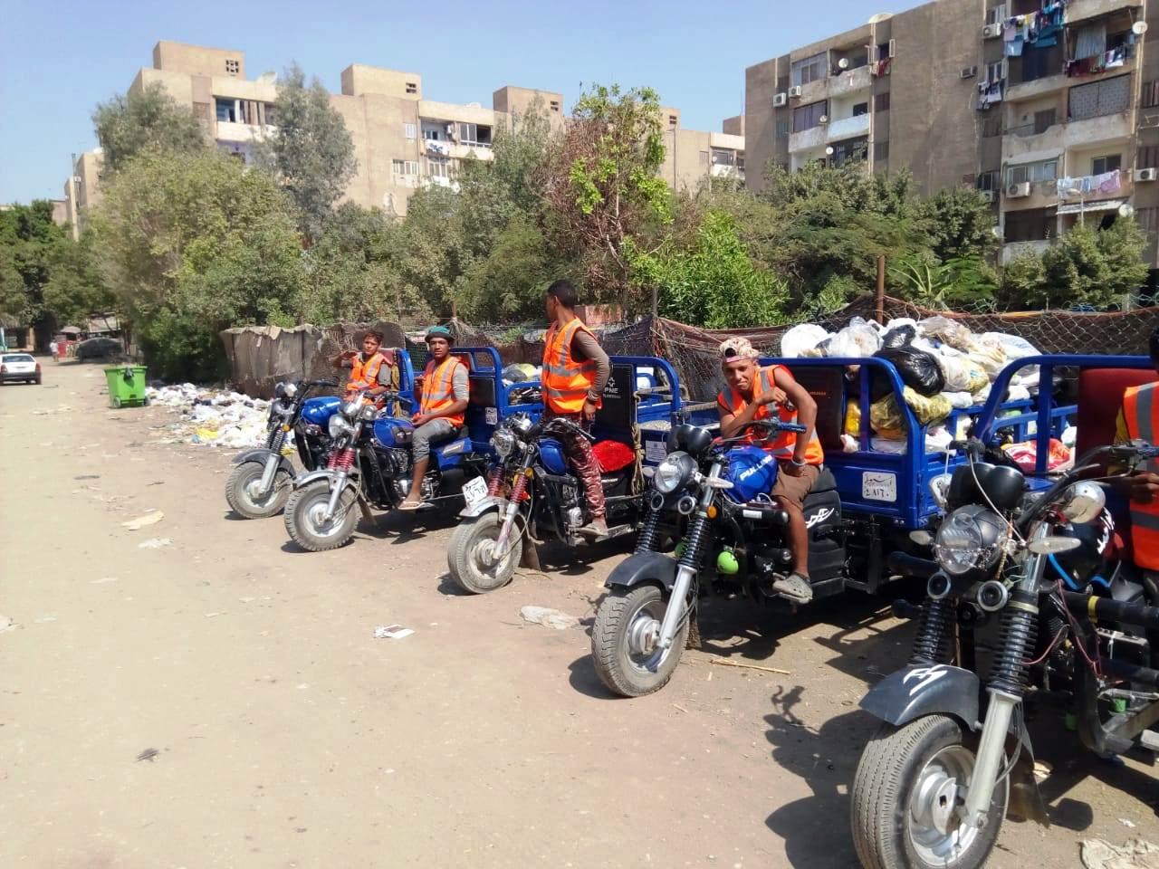 جامعو القمامة يتعهدون إمبابة وشبرا  (2)