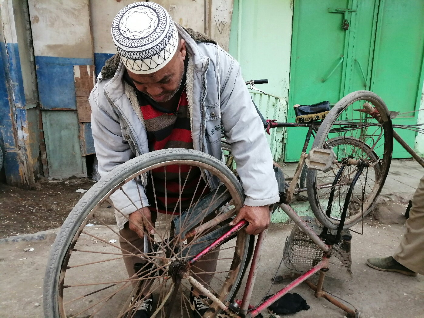 Mohamed Hassan during bicycle repair