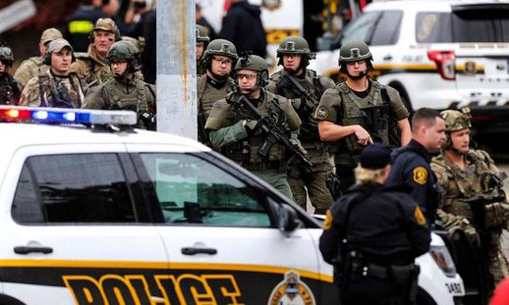 الشرطة الأمريكية بعد العجوم على المعبد اليهودى