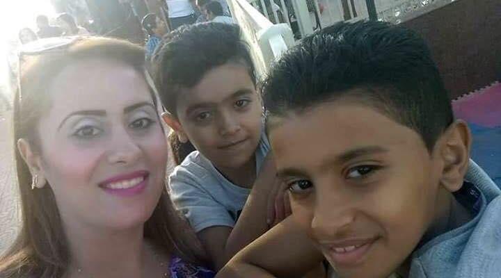 مس ريهام مع طفيلها مينا وفادى
