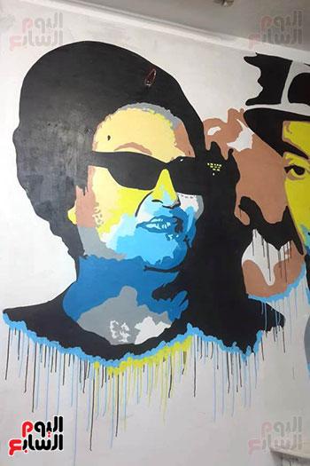 ياسر الدينارى.. رسام احترف فن  الجرافيتى وجداريات الشوارع ببنى سويف (14)