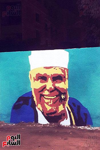 ياسر الدينارى.. رسام احترف فن  الجرافيتى وجداريات الشوارع ببنى سويف (10)