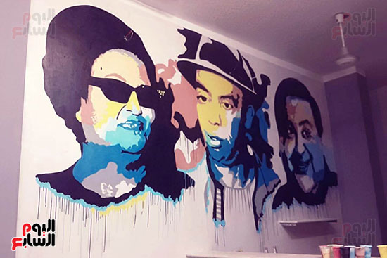 ياسر الدينارى.. رسام احترف فن  الجرافيتى وجداريات الشوارع ببنى سويف (12)