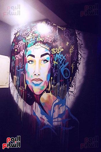 ياسر الدينارى.. رسام احترف فن  الجرافيتى وجداريات الشوارع ببنى سويف (8)