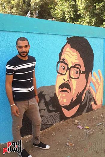 ياسر الدينارى.. رسام احترف فن  الجرافيتى وجداريات الشوارع ببنى سويف (1)