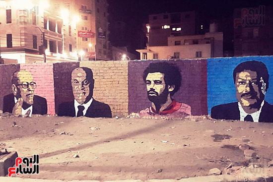 ياسر الدينارى.. رسام احترف فن  الجرافيتى وجداريات الشوارع ببنى سويف (13)