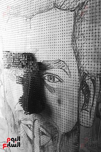 ياسر الدينارى.. رسام احترف فن  الجرافيتى وجداريات الشوارع ببنى سويف (9)