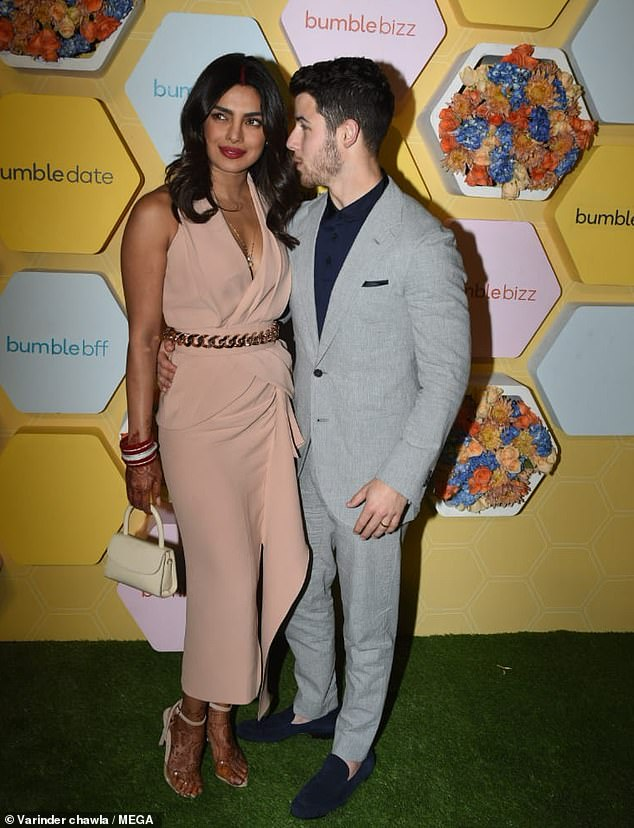 7049674-6465245-The_duo_made_their_first_red_carpet_appearance_as_a_married_coup-m-44_1544051299496