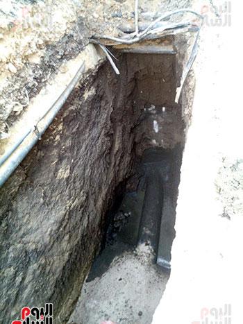جانب من تغيير مسارات خطوط الصرف أسفل طريق الكباش