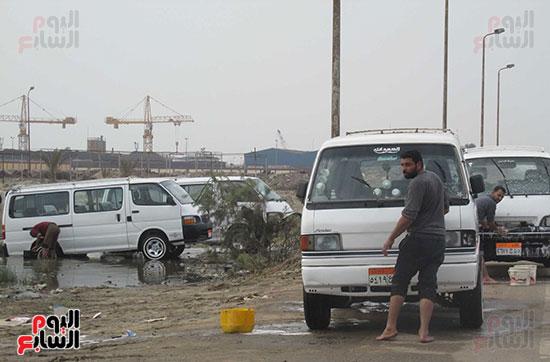 جانب من الغسيل الجماعى على طريق بورسعيد/ دمياط