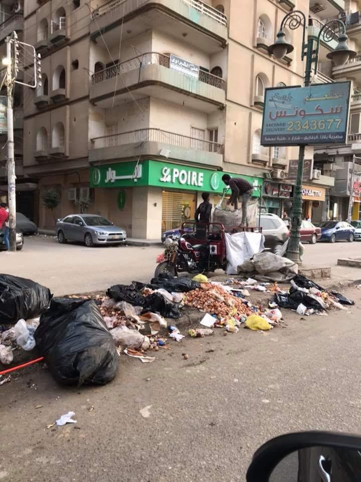 انتشار القمامة بشارع طلبة عويضة (1)