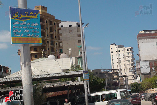 لافتات شراء العملات الملغاة فى شوارع دمياط (5)