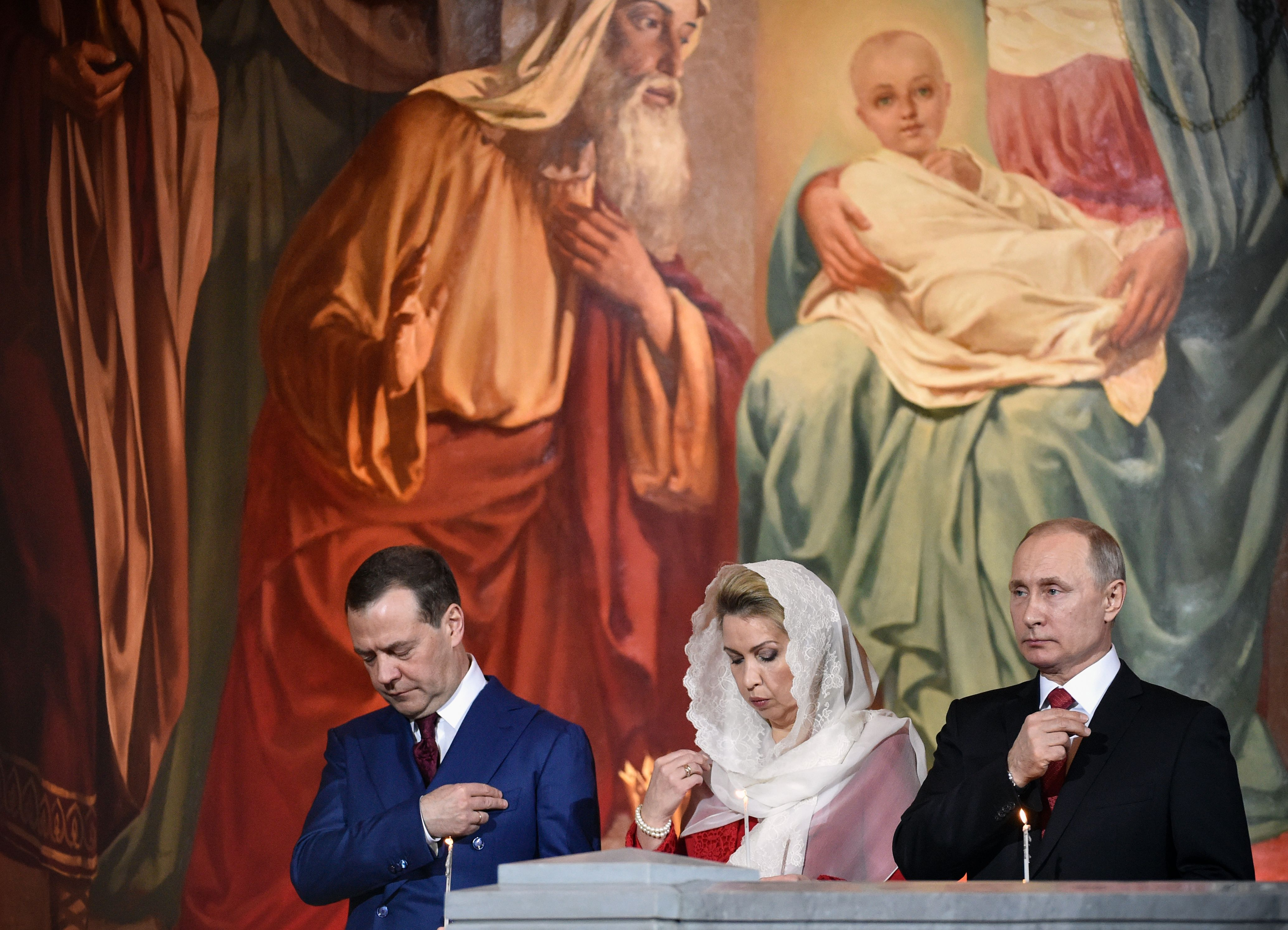 بوتين وزوجته فى قداس عيد الفصح