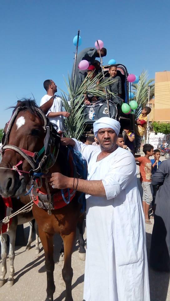 أهالي مدينة الاقصر وإسنا يخرجون في دورة رمضان بمواكب إحتفالية (8)