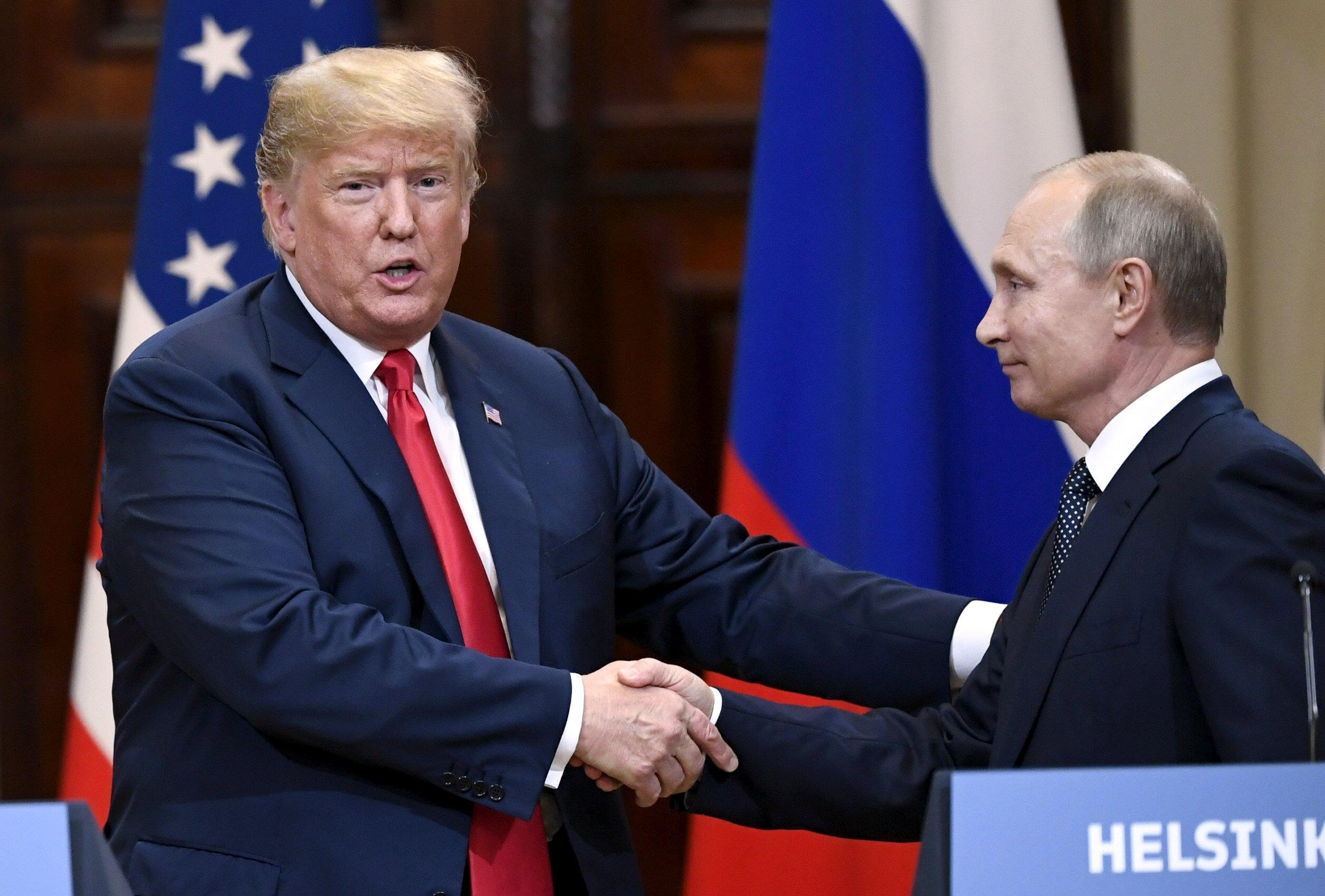 بوتين يضافح ترامب