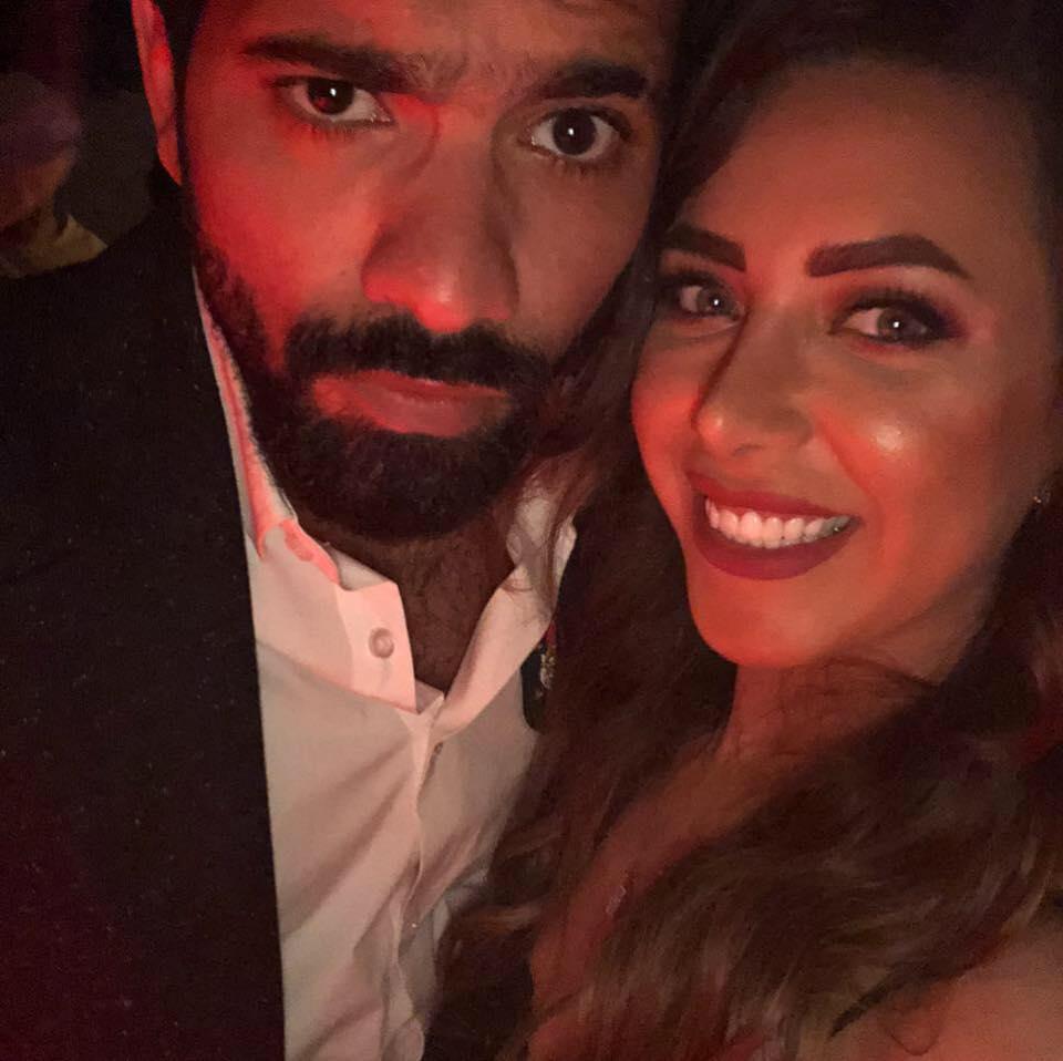 هبة عبد العزيز وزوجها