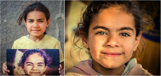 أطفال جزيرة الدهب يحملون صورهم (1)