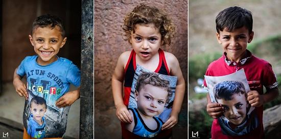 أطفال جزيرة الدهب يحملون صورهم (3)