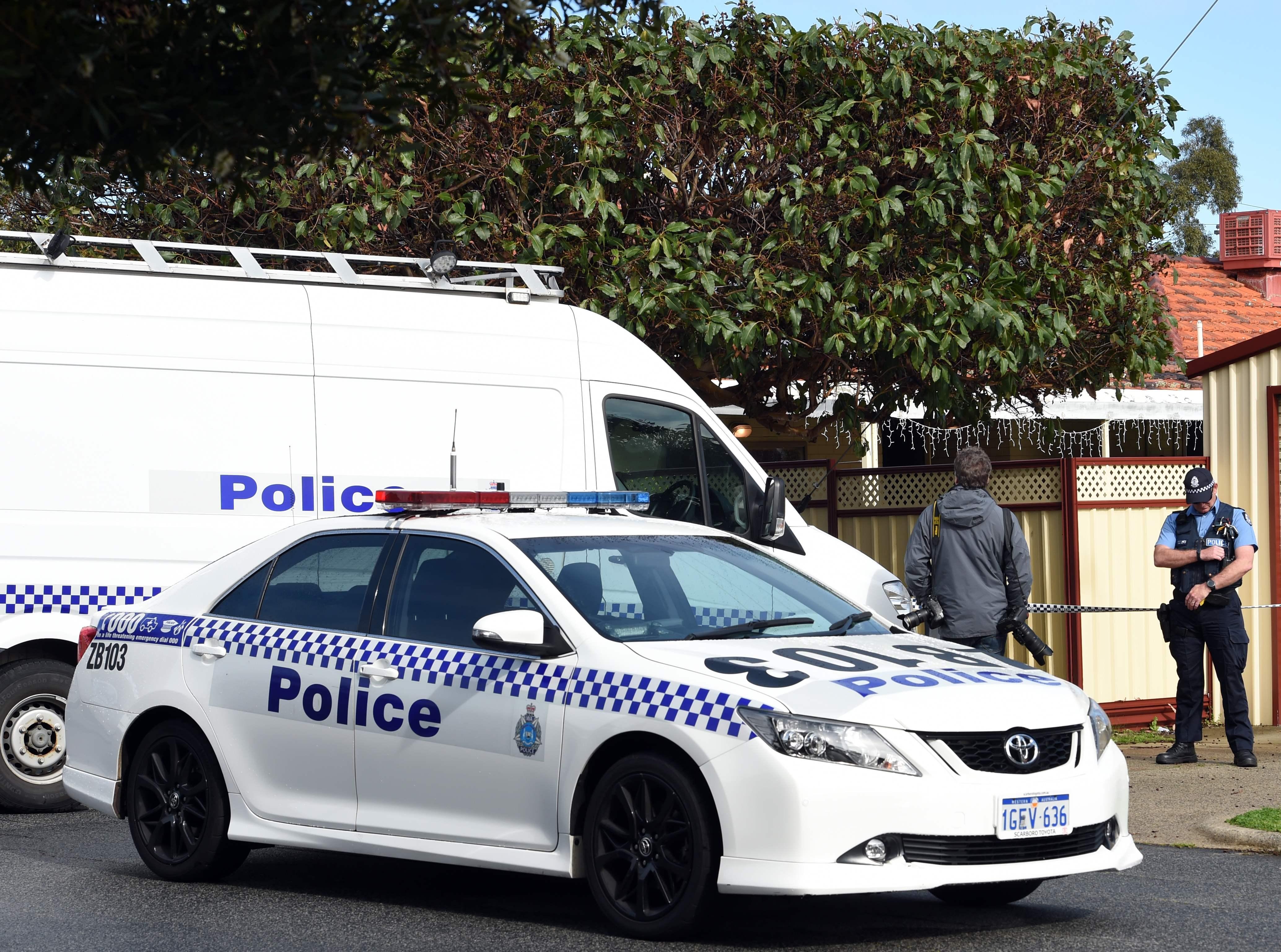 الشرطة الاسترالية بمحيط المنزل