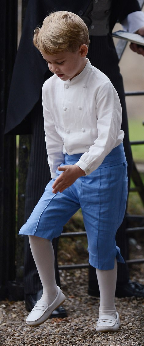 4499002-6199275-The_prince_as_a_pageboy_George_wore_a_collarless_white_shirt_sky-m-3_1537771515251
