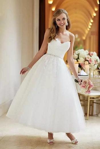 b833b47a7 أخر كلام | كل ما تحتاجين معرفته عن اختيار فساتين زفاف متوسطة الطول
